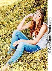 jeans - Romantic young woman posing outdoor.