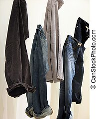 Jeans - shot of a few jeans hanging on display.