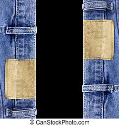 Jeans texture with leather label isolated black background