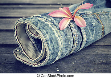 Jeans with frangipani flower