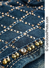 Jeans with pockets close-up decorated with rhinestones, may...
