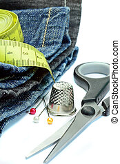 Jeans with sewing utenstils