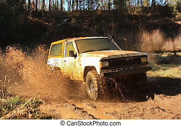 Jeep adventure race - A jeep speeding along river and mud....