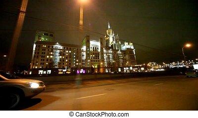 Jeep passing in front of Kotelnicheskaya Embankment Building