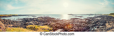 JEJU ISLAND, SOUTH KOREA - AUGUST 18, 2015: Panoramic shot of seascape with vulcanic stones all around at Jeju Island - South Korea