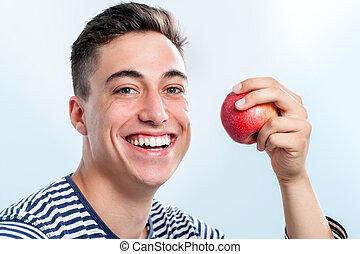 jelentékeny, fiatalember, kiállítás, egészséges fogazat, mosolyog.