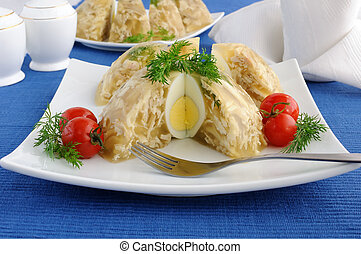Jellied chicken decorated with egg and dill in the context of