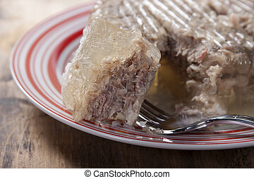 Jellied meat on a plate.