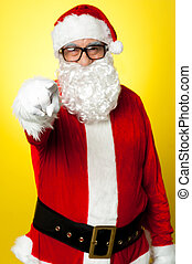 Jelly-belly Santa in spectacles pointing at you. Isolated on...