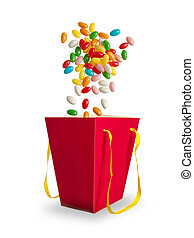 Jelly color beans falling in red bag