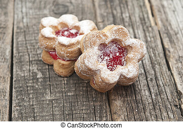 Jelly cookies flower with red jam homemade on vintage table top
