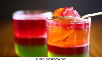 jelly fruit colored puff in a glass beaker