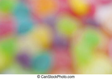 Jelly fruits on abstract background blur