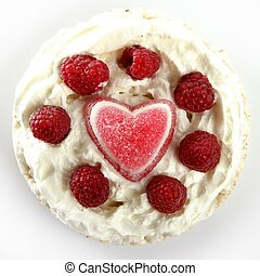 Jelly heart cream cake with raspberries