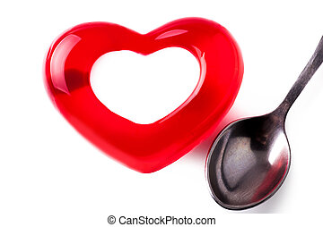 jelly in the form of heart with a spoon