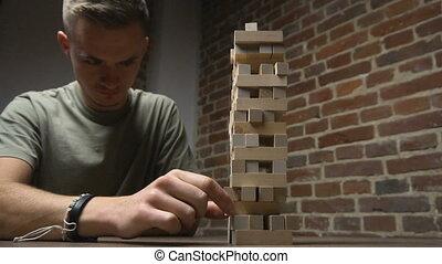 Jenga Tower Falls while Boy's Turn - Jenga game, near the...