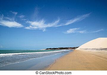 Beautiful sand dune and blue sky at Jericoacoara, Ceara, Brazil
