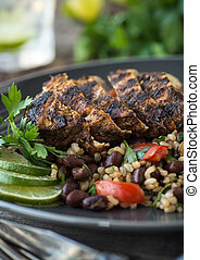 Jerk Chicken - Sliced jerk chicken with black bean and rice ...