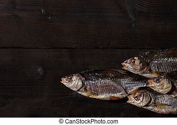 Jerky or dried salted roach, delicious clipfish on wooden ...