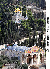 JERUSALEM - DEC 12 2008:GChurch of All Nations and St. Mary Magdalene Church on Mount of Olives in Jerusalem, Israel. The Mount has been a site of Jewish and Christian worship since ancient times