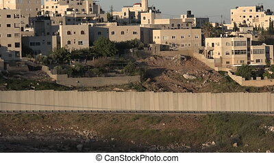 JERUSALEM, ISR - MAY 01 2015:The Israeli West Bank barrier in East Jerusalem. It protects Israel civilians from Palestinian political violence such as terror suicide bombing attacks.