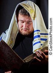Jewish man in prayer at the Olive Mountain during Jewish holiday of Sukkot