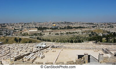 Jerusalem old city and modern city skyline from Mount of Olives Jewish Cemetery