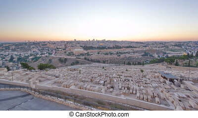 Jerusalem panorama view over the City day to night timelapse with the Dome of the Rock from the Mount of Olives.