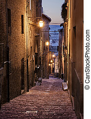 Jesi, Ancona, Marche, Italy: picturesque narrow alley at night in the old town of the medieval Italian city