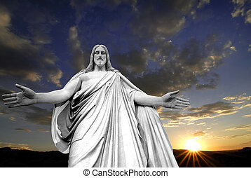 Jesus and a Sunset - Statue of Jesus Christ with hands...