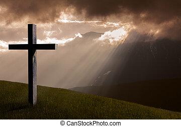 Jesus Christ cross. Christian wooden cross, sky, dramatic light, mountains, sunset