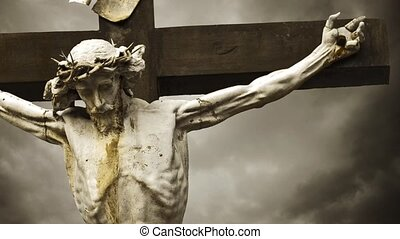 Jesus Christ crucified. The Crucifixion. Christian cross with Jesus Christ statue over stormy clouds time lapse. 1920x1080, 1080p, hd format.