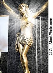 Jesus Christ on stone cross with mystic rays of light
