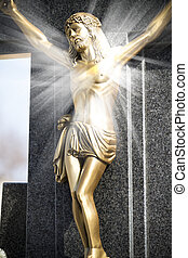 Jesus Christ on stone cross with mystic rays of light