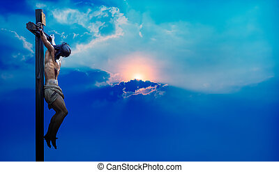 Jesus Christ on the cross over blue dramatic sky background