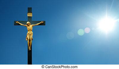 Jesus Christ on the cross over blue sky background