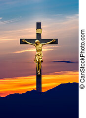 Jesus Christ on the cross over sky background