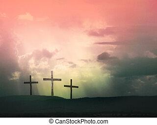 Jesus Christ on the cross - Three crosses against dramatic...