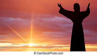 Jesus Christ statue against beautiful sky background