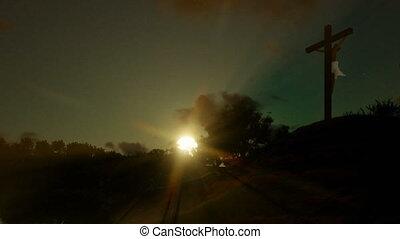 Jesus cross against beautiful sunset