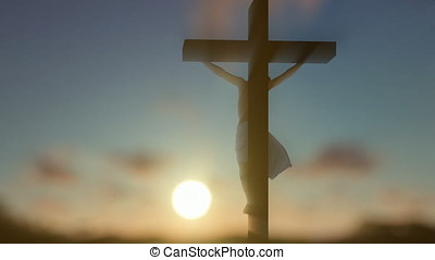 Jesus cross against blurry sunrise, panning