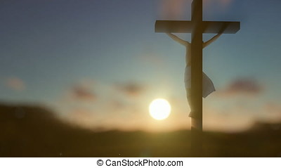 Jesus cross against blurry sunrise, zoom out