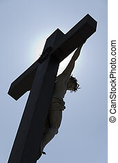 jesus cross against the light