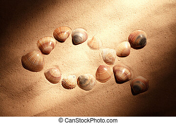 Jesus Fish - Jesus fish symbol made from shells on sand...