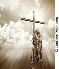 jesus holding a cross