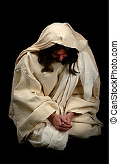 Jesus in Prayer - Jesus praying on his knees over a black...