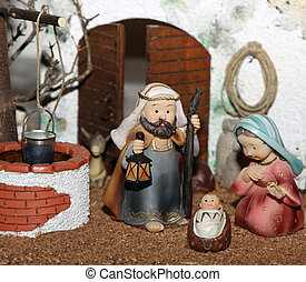 Jesus Joseph with the beard and the stick and Mary in a manger on Christmas and a well 1