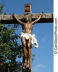 Jesus on the cross - Sculpture of suffering Jesus on a wood...