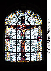 Jesus on the Cross, stained glass window in Notre Dame des Blancs Manteaux in Paris, France
