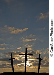 Jesus on the Cross with sunset in the background